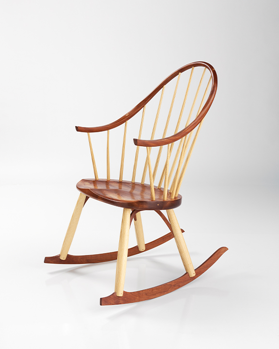 Continuous Arm Rocker in Cherry